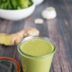green onion miso salad dressing n a glass jar with salad