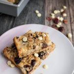 white chocolate cranbyerr oat bars with white chocolate chips and cranberries