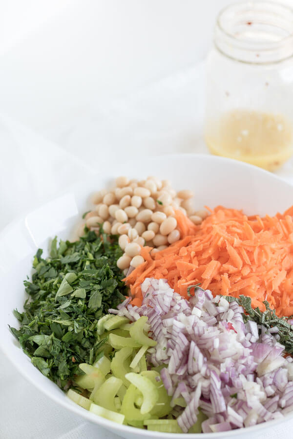 simple bean salad ingredients - white beans, carrots, celery and red onion