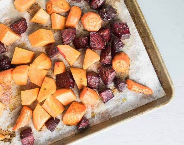 roasted beets carrots and sweet potatoes on baking sheet