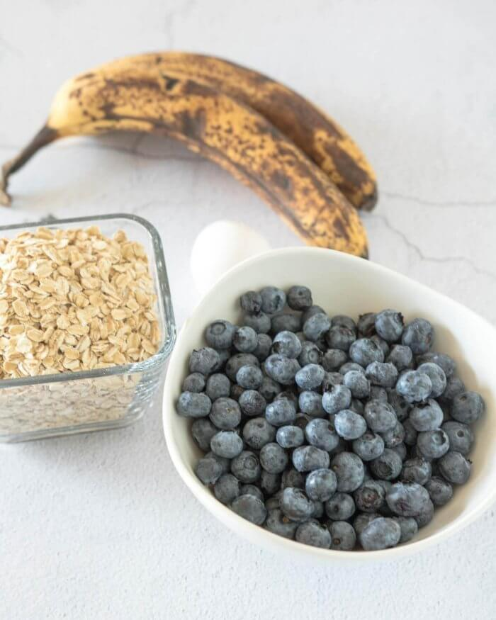 ingredients for baked banana oatmeal, oats, blueberry and ripe bananas