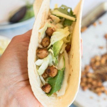 taco filled with chickpeas, slaw and vegan queso