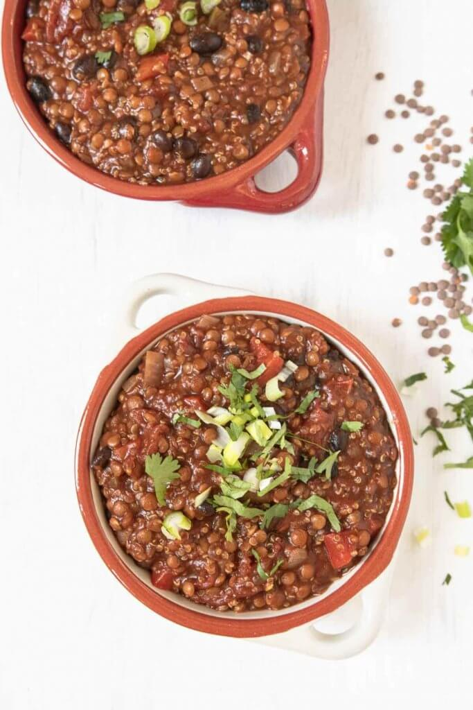 vegetarian lentil chili made with stout in two bowls,top view