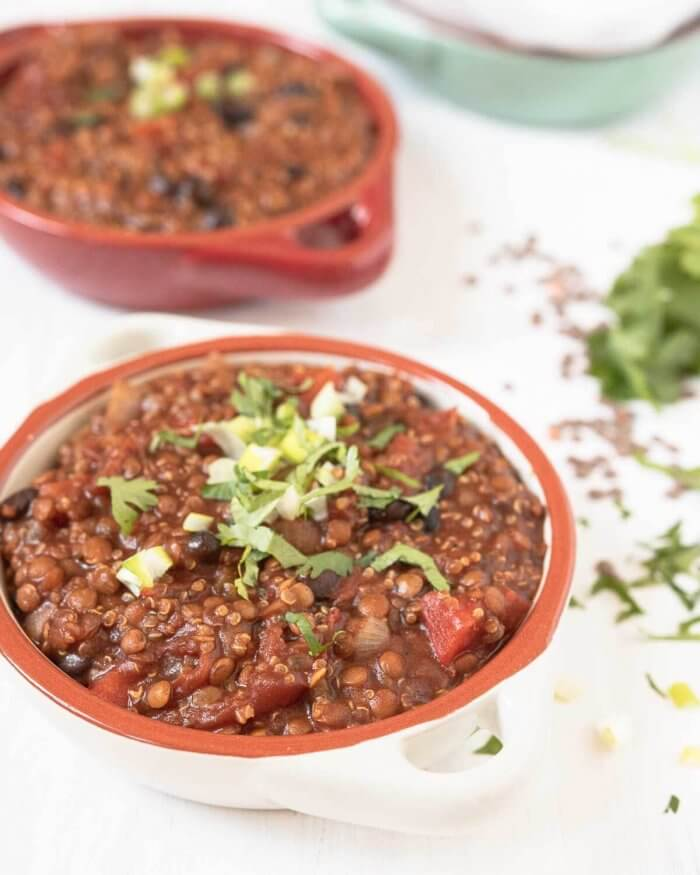 lentil and quinoa chili with guiness in two bowls