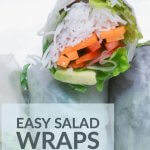 fresh salad wraps with carrots, avocado, rice noodles and fresh herbs