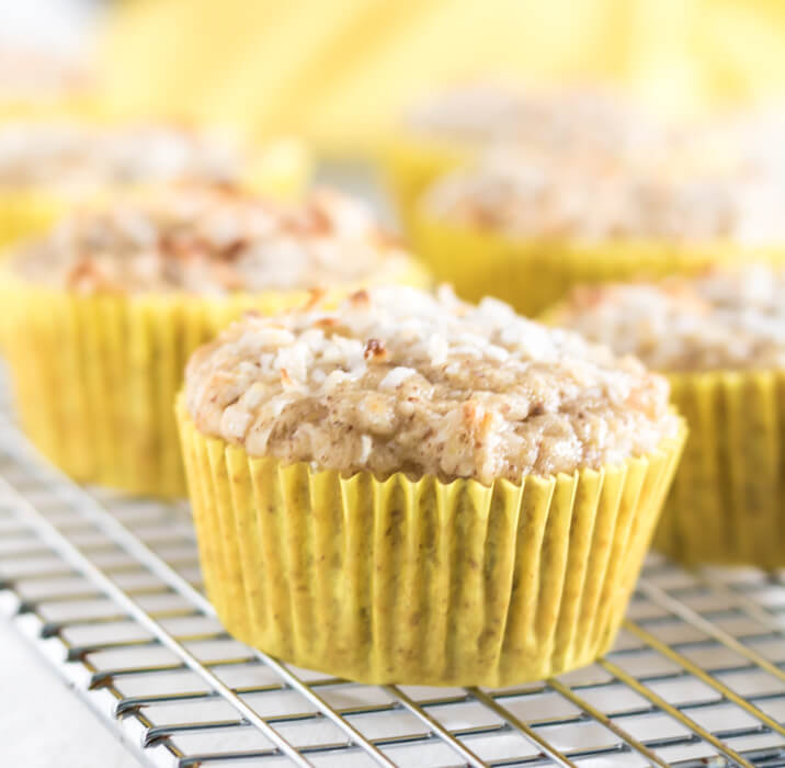 healthy pineapple coconut muffins in yellow muffin cups