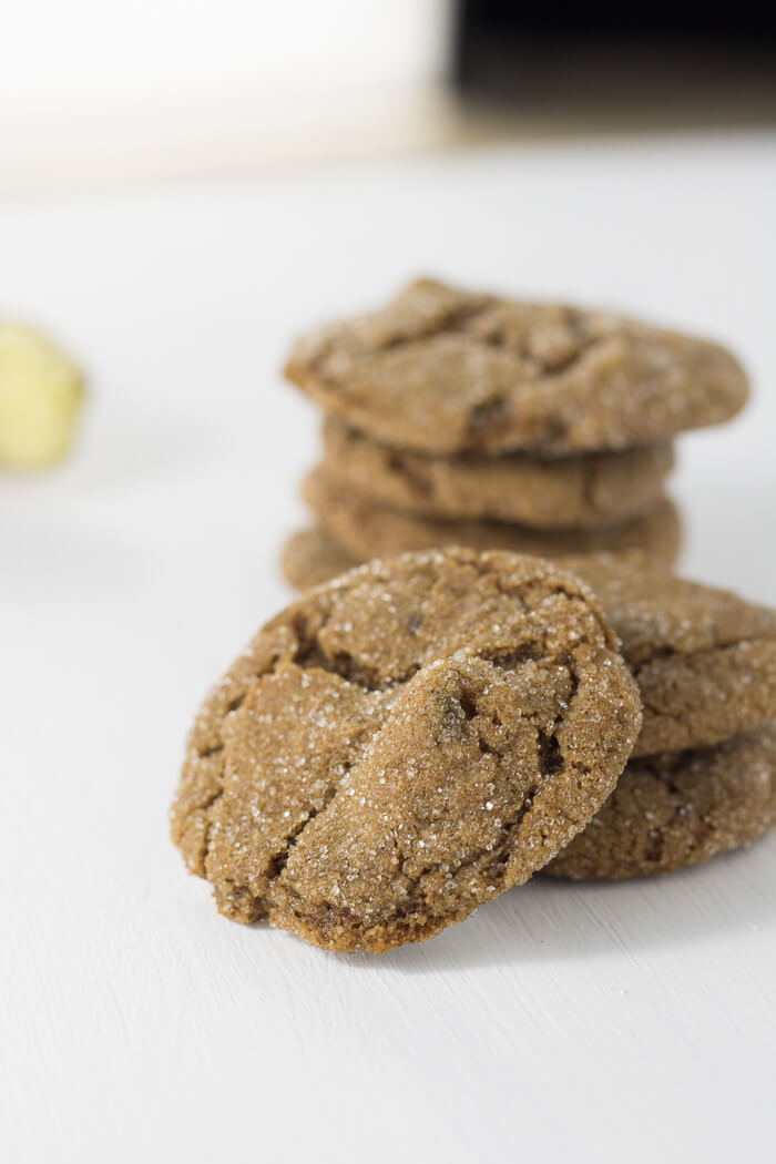 a stack of ginger molasses cookies with fresh ginger