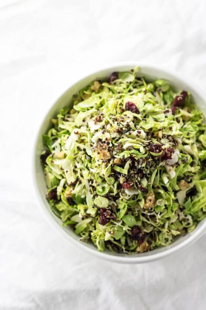 top view of shaved brussels sprouts and cranberry salad with quinoa