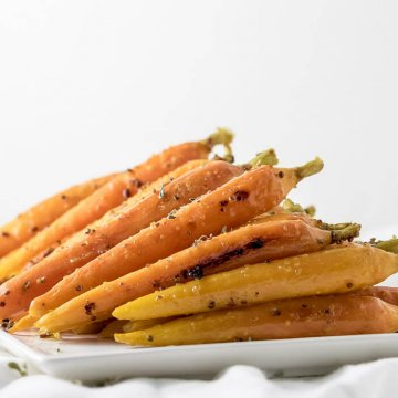 oven roasted carrots on a plate ready for serving