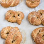 home made whole wheat pretzels on a baking sheet