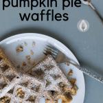 pumpkin pie waffles on a plate with powdered sugar