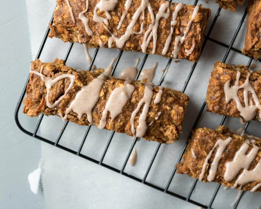 Carrot cake breakfast bars with cinnamon frosting
