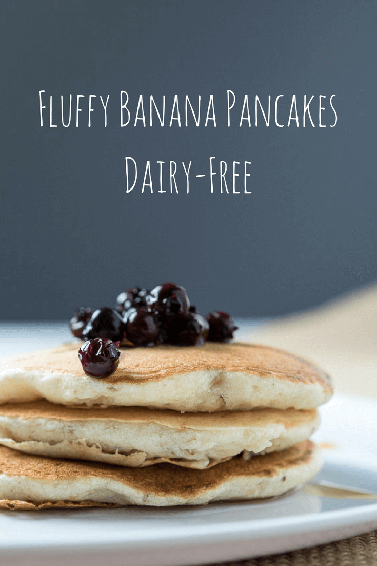 a stack of fluffy banana pancakes with blueberries