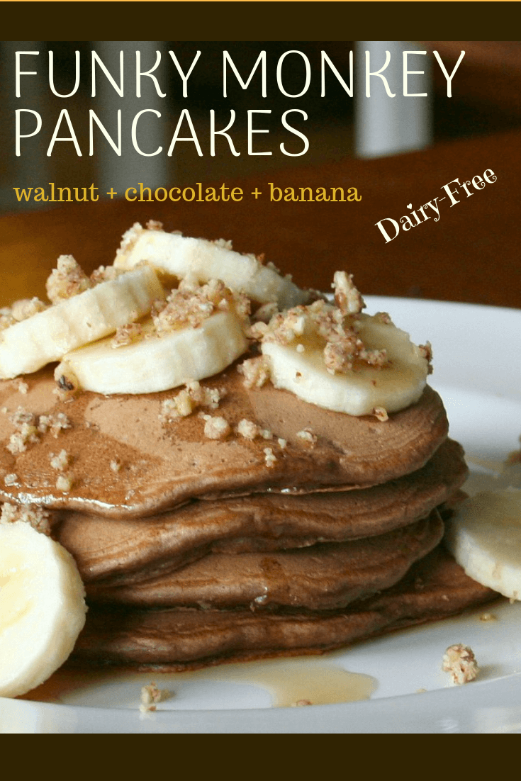 a stack of chocolate pancakes topped with banana and walnuts
