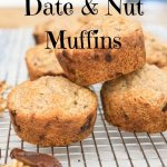 banana date nut muffins on a baking rack