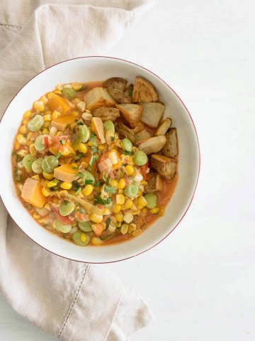 a bowl of succotash with roasted potatoes