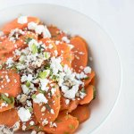 glazed carrots with feta and pecans in serving bowl