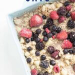 berry baked oats in a baking dish with a serving spoon