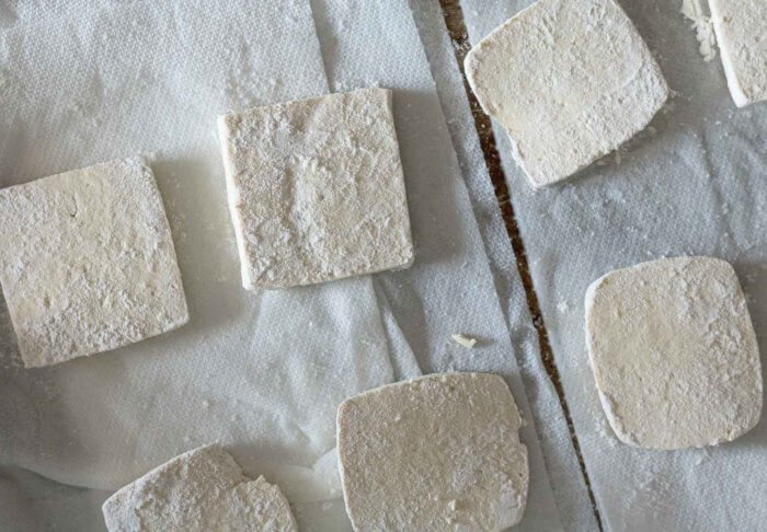 tofu dusted with flour for frying