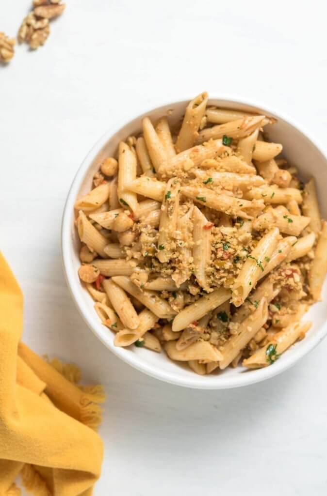 green olive tapenda and chickpea pasta with walnuts and parsley, pasta topped with breadcrumbs
