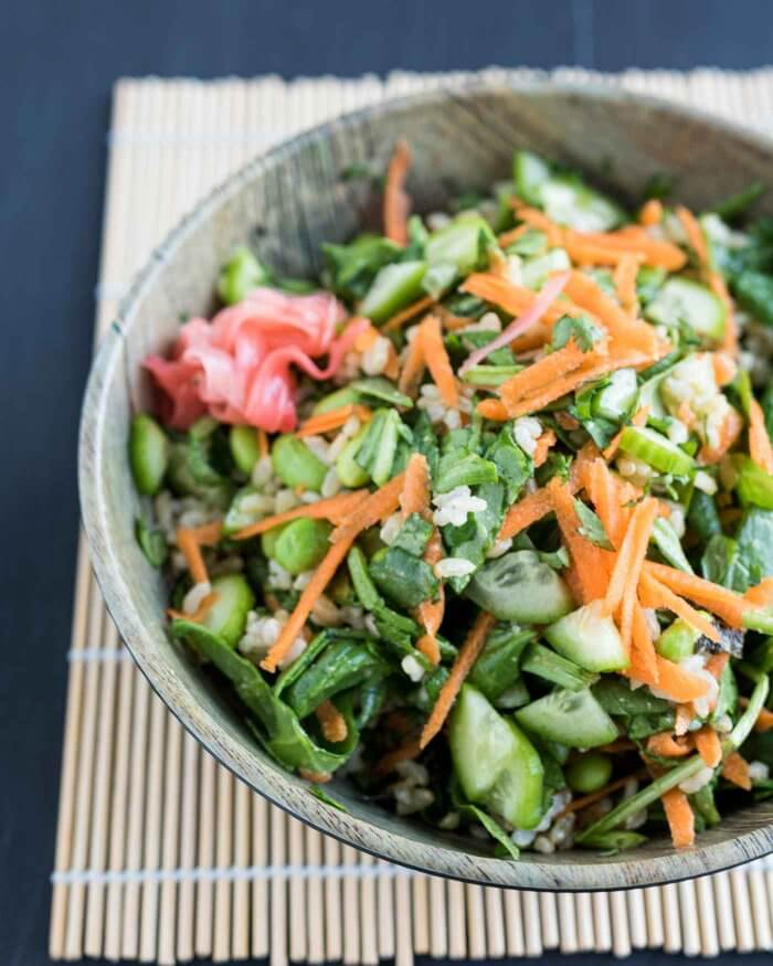 tossed sushi salad - carrots, cucumbers, edamame, rice and greens