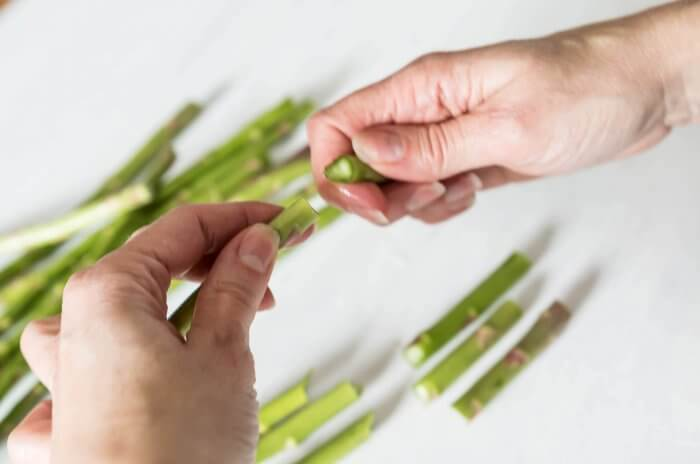 the tough ends of asparagus snap off