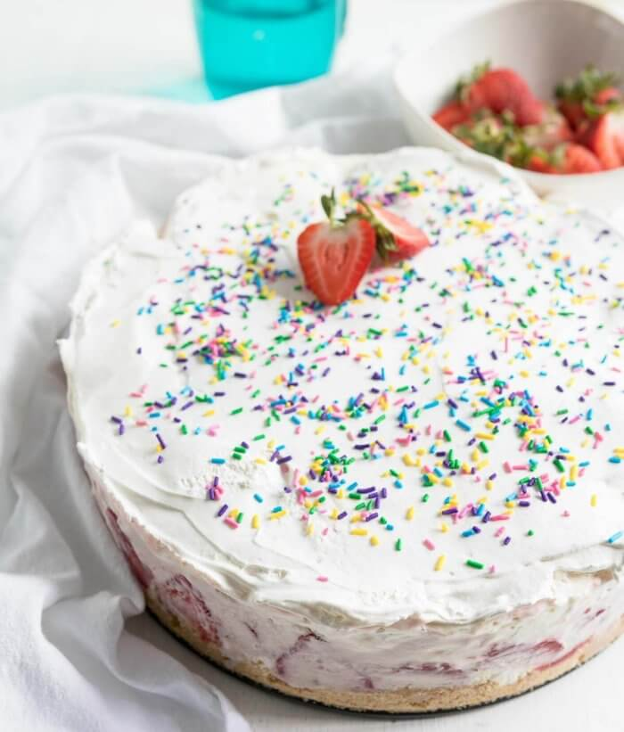 ice cream cake with sprinkles and strawberries