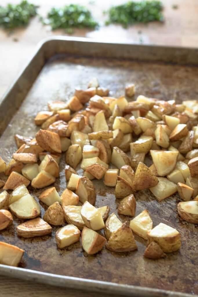oven roasted potatoes on a baking sheet