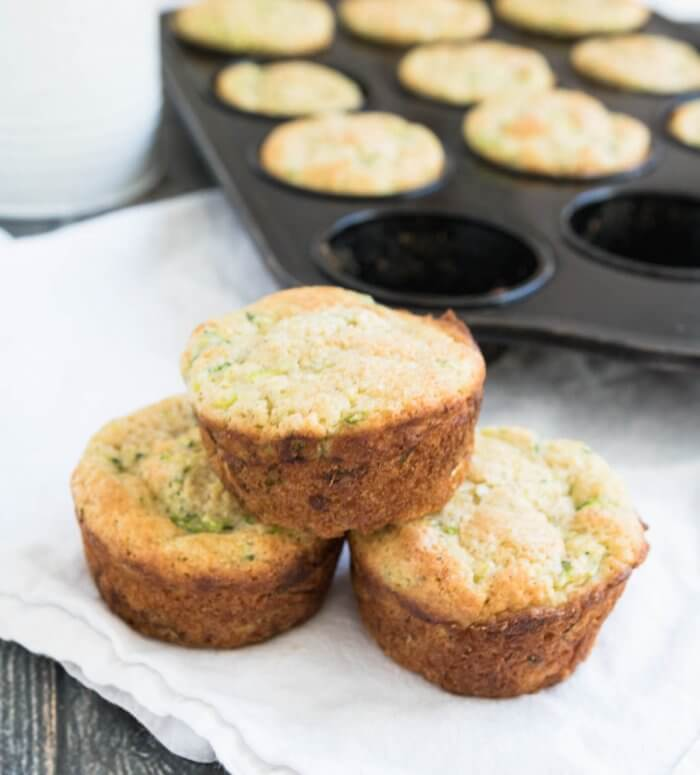 a stack of golden zucchini and lemon muffins