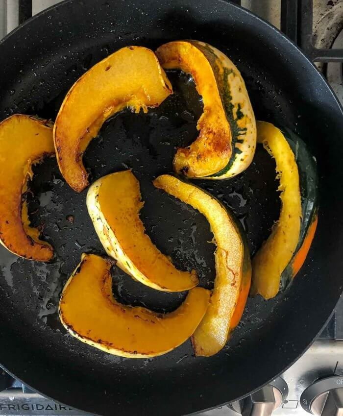 caramelize slices of squash in a fry pan before adding to slow cooker