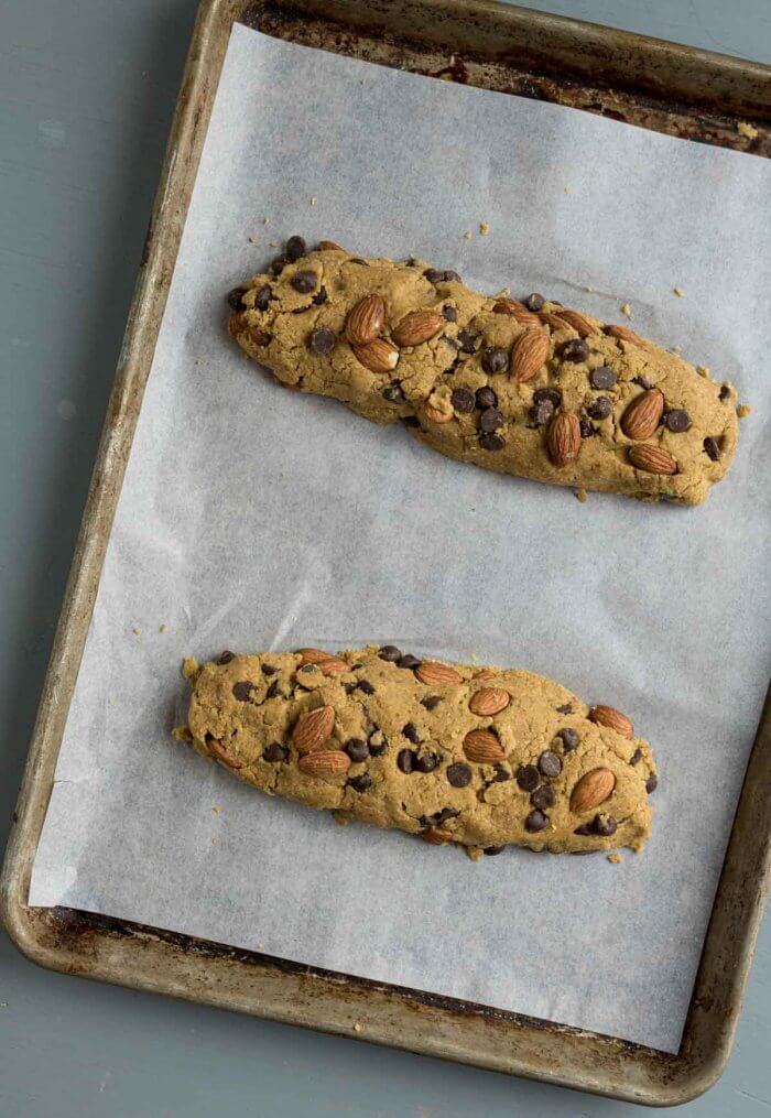 whole wheat biscotti shaped into logs for the first baking, two logs can share the same baking sheet