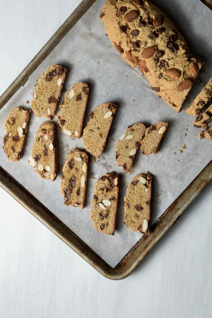 a baking sheet with sliced biscotti