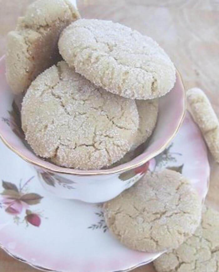sesame cookies stacked in pink tea cup