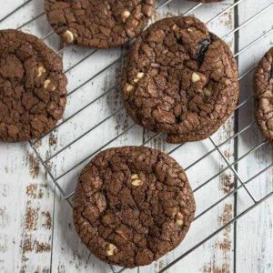 dark chocolate crinkle cookies on a cooling rack