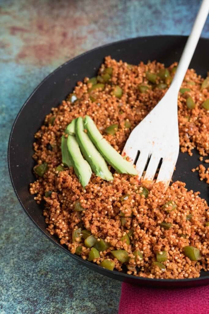 spanish millet in a skillet with avocado