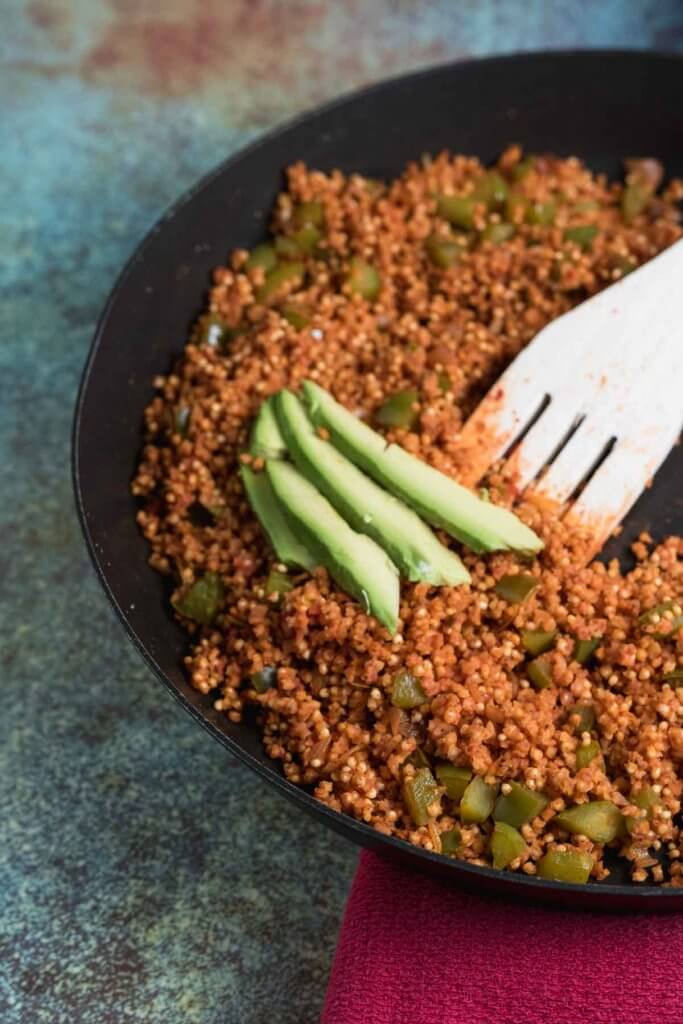 millet fried with tomato, onion and green pepper for an easy whole grain side dish