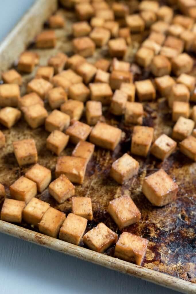 crispy baked tofu on a rimmed baking sheet